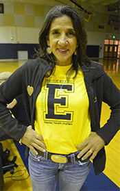 """Christy Buck, executive director the Mental Heath Foundation of West Michigan, wears her East Grand Rapids shirt with the messages """"Be Nice"""" and """"Hearts of Gold"""""""