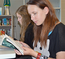 Freshmen Mary O'Connor (left) and Kayli Nagelkerk had their reading choices greatly enlarged by a grant of 500 books to their English classroom library