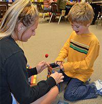 Thornapple Kellogg senior Lauren Webster and Frankee Keller get started playing