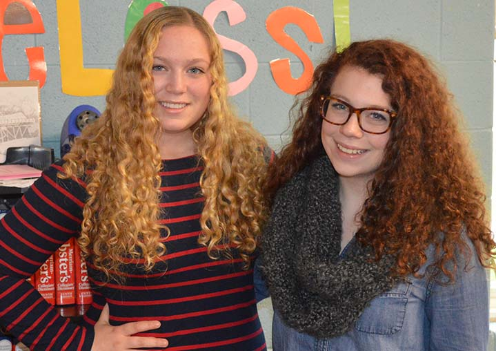 Katie Elwell (left) and Shelby Oleksy are taking a Ferris State University class at Rockford High School