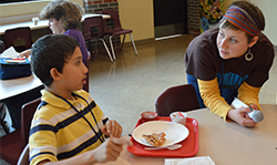 Seventh-grade student Anthony Sanchez chats with KSSN leader Alison Corso