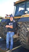 Derek Plant was one of the students at Thornapple Kellog High School who celebrated Farmer's Day by driving his Challenger  tractor to school