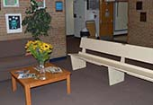 A bench in the Zinser entry way helps direct visitors to the office