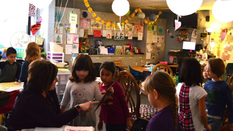 Students work under the glow of paper lanterns in Jennifer Blackburn's classroom