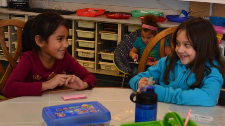 Galilea Villagomez, left, and Yudexy DeLos Santos sit at their classroom