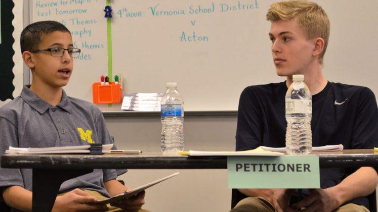 George Samra, left, makes a point as partner Finn Mohrer looks on