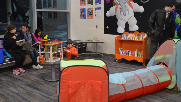 The children's section of the library is personalized with Kelloggsville Rocket touches
