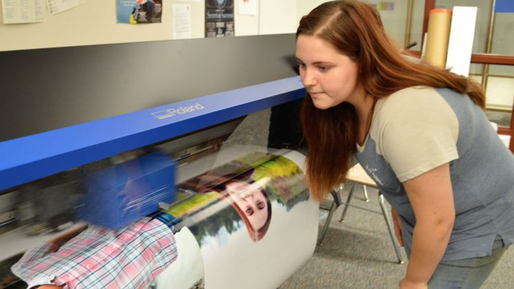 Senior Melissa Bare takes a closer look at the quality of pictures being printed in large size