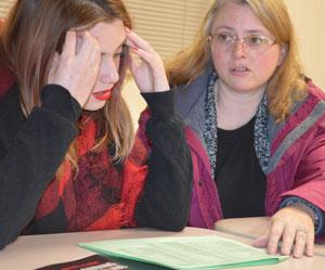 Dual-enrollment English? Accounting? Speech? Ladies Ensemble? Junior Gwen Hackett and her mother, Christy Baldwin, discuss senior year class choices