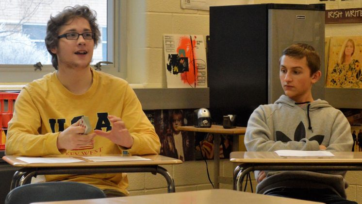 Maxwel Thompson weighs in during a student-led poetry discussion as classmate Levi Trader looks on