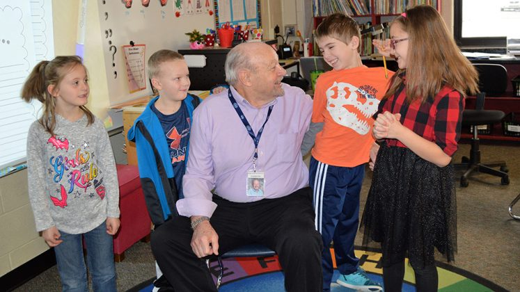 Grandpa Dale has a little fun with first-graders (from left) Brookelynn Kerker, Elijah Barnum, Jack Hohendorf and Sophie Zachow