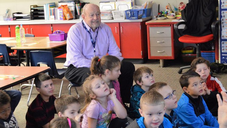 Grandpa Dale takes a little time to listen to a story with the first-grade class