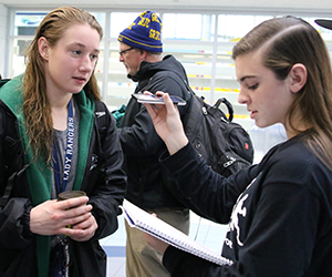 Sports reporter Molly Donovan interviews senior Felicity Buchmaier after her win at the Division 2 state swim championship in October (photo courtesy Tricia Donovan)