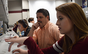 """Terry Blevins views a student's short film, titled """"Violation"""" about the Time's Up movement, which she plans to submit to Girls Impact the World Film Festival for a possible $5,000 award"""