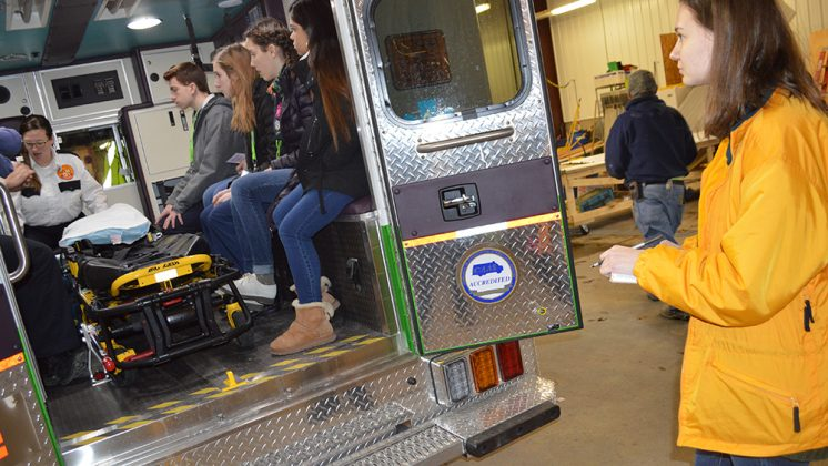 Allison Gates takes notes outside a Life EMS ambulance during Groundhog Shadow Day; Alison was shadowing School News Network reporter Morgan Jarema to find out about careers in writing