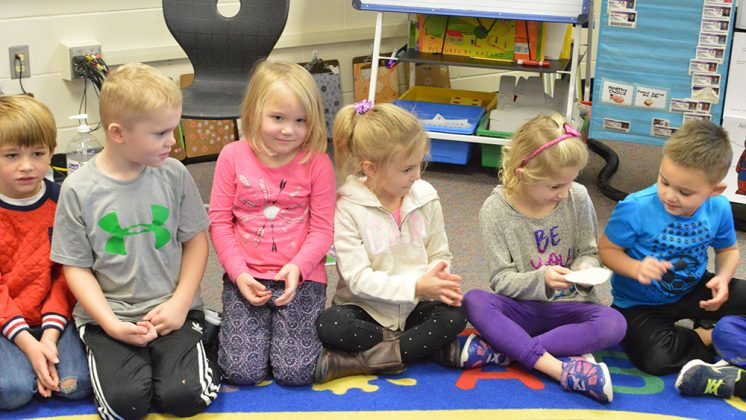 Kindergartners pass around a bean bag during a Social Thinking lesson on expected and unexpected behaviors