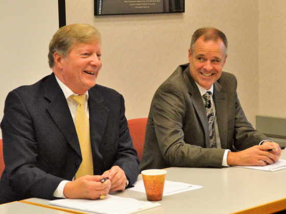 Superintendent Michael Shibler, left, enjoys a light moment with Assistant Superintendent Doug VanderJagt at an Inter-School Advisory Council meeting of parent leaders
