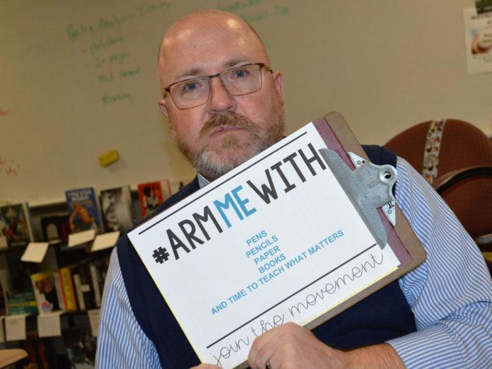 Jeffrey Larsen, Lowell High School AP literature teacher, would rather be armed with school supplies
