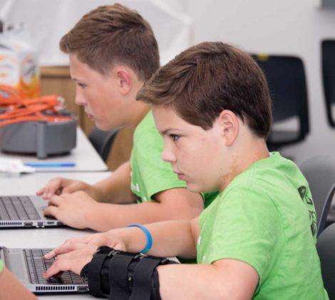 Gabe Cota, eighth grade, Hudsonville homeschooler; and Jacob Tomasko, eighth grade, East Rockford Middle; work on design ideas