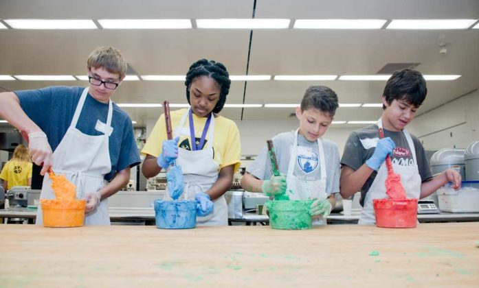 Matt Kroll, ninth grade, Talmadge homeschooler; Dasani Rosser, ninth grade, Wyoming Junior High; Zev Deaner, seventh grade, EGR Middle; and Nate Gil, eighth grade, FH Eastern Middle; make frosting
