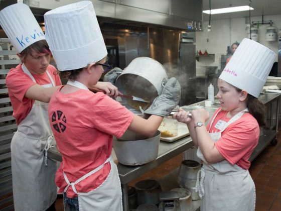 Kevin Williams, eighth grade, Lee Middle; Allie Hoven, seventh grade, Wyoming homeschooler; and Isabella Marino, seventh grade, Grand Rapids homeschooler; work as a team to strain burrito sauce
