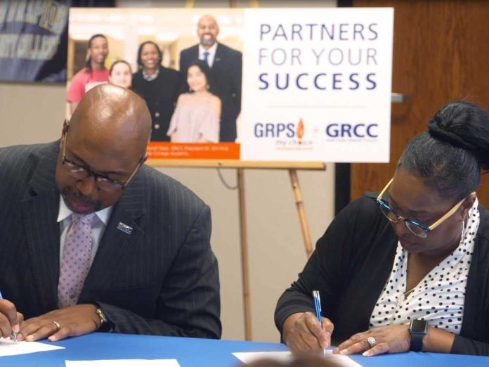 GRCC President Bill Pink and GRPS Superintendent Teresa Weatherall Neal signed on to provide more college opportunities for students
