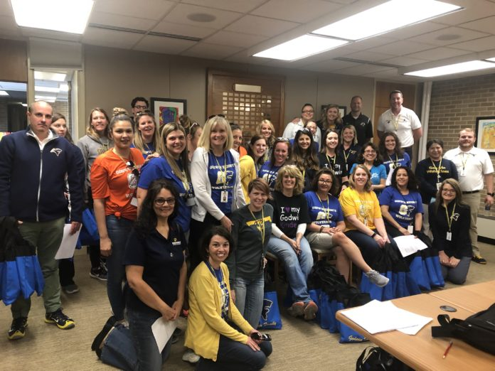 (Courtesy Photo) Teachers and staff assemble before heading out to visit the homes of children who will be kindergarten age this fall