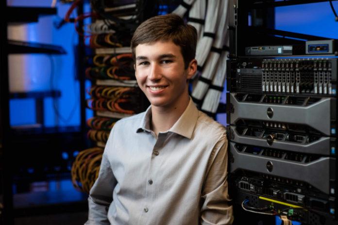 Senior Evan Grahs in the high school computer control room