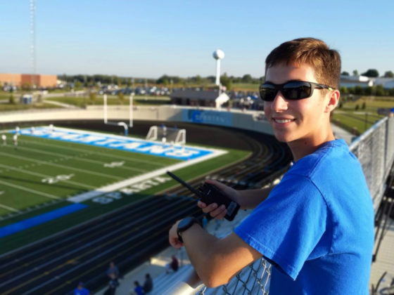 Evan working the high tech displays at the high school stadium