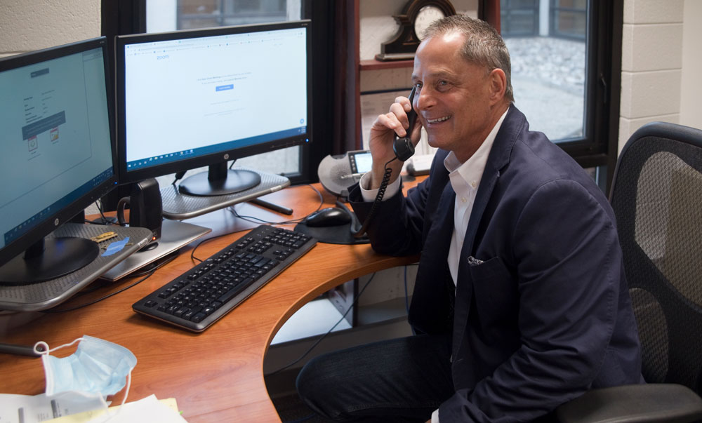 Gary Moline, counselor with Student Services, takes calls from prospective students about enrolling at the Tech Center