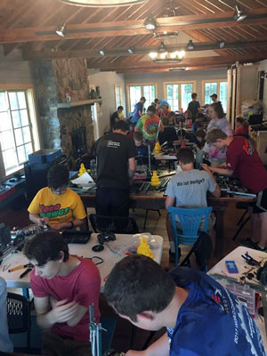 Mike Evele's work doesn't take a pause over the summer; he works with students year-round, like at this robot summer camp